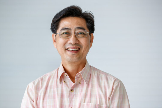 Portrait of warm personality senior older man wearing eyeglasses with smile face poses to a camera with self-confidence and good looking