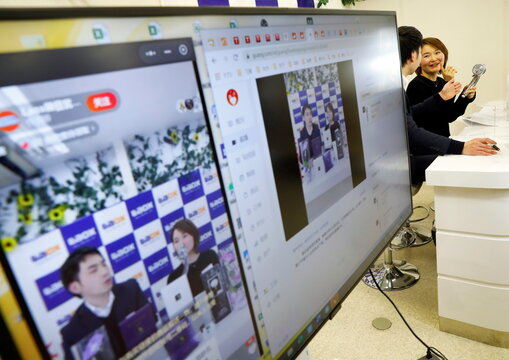 Employees of Laox introduce skin care products during a livestreaming session for their e-commerce sales event in Tokyo