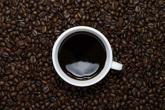 Hot Black Americano Coffee In White Cup Presented With Roasted Coffee Beans