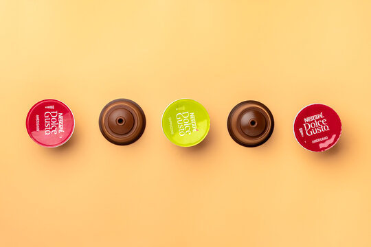 January 2021,Milan, Italy Set of Nescafe Dolce Gusto coffee capsules isolated on beige background Top view Flat lay Drink obtained from dosed capsule with roasted, ground, compressed natural coffee