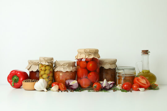 Different pickled food and ingredients on white background