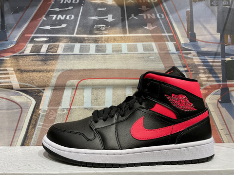 FRESNO, UNITED STATES - Feb 10, 2021: Photo of the NEW Air JordanNike black and red shoe store display in 2021