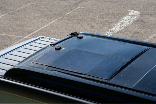 top down view of the pop-top roof of a camper van with felxible solar panels installed
