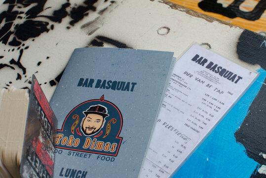 "Bar ""Basquiat"" in Javastraat street, Oost, Amsterdam, Netherlands. View of menu on the table."