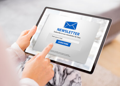 Woman subscribing to weekly newsletter online