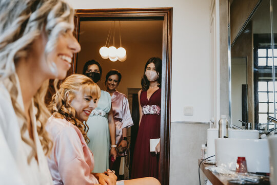 Group of bridesmaids with surgical masks before the wedding