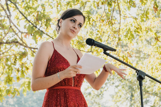 Young woman reading a speech