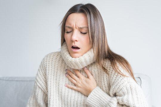 Woman having breath difficulties. Shortness of breath. Coronavirus cough breathing problem