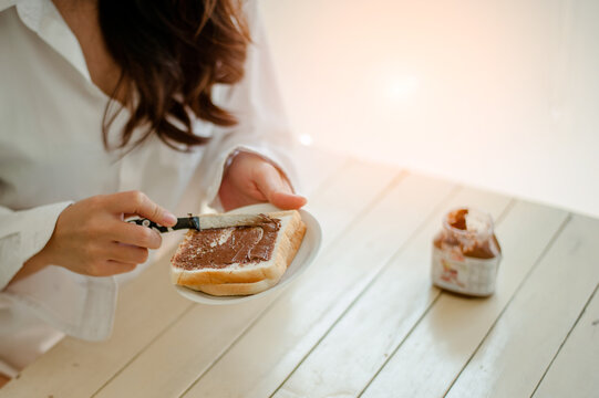 Midsection Of Woman Making Breakfast At Home