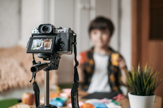 Boy is a vlogger. The boy is streaming for his YouTube channel. The child is broadcasting live on the Internet.