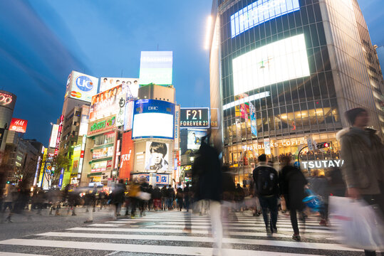 Tokyo, Japan - Janury 17, 2016: An abstract view of Commuters crossing one of the most famous crossings in Tokyo, the Shibuya crossing in Tokyo's shopping district.