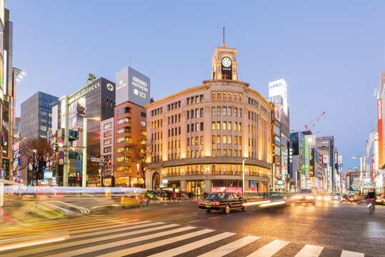 Tokyo, Japan - January 18, 2016:A black taxi waiting of its turn in the night Traffic, during rush hour at the Mitsukoshi Ginza Store in Ginza, Tokyo, Japan at night.