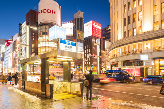 Tokyo, Japan - January 18, 2016: A tourist taking a phtot at the Ginza Metro Station in Tokyo. Night life at Ginza district at night and is one of the most famous city night views in Japan.