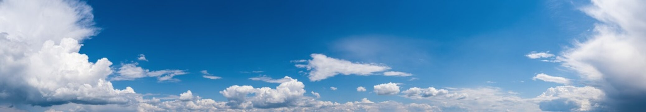Fuffy clouds in blue sky. Summer good weather skyscape high resolution background.