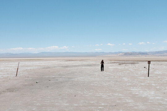 Full Length Of Woman Standing On Landscape Against Sky