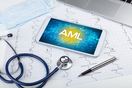 Close-up view of a tablet pc with AML abbreviation, medical concept