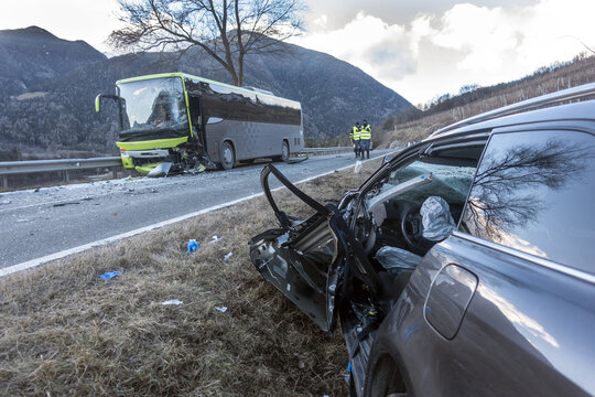 Violent head-on collision between a bus and a car traveling in the opposite direction at the end of the day. A victim due to high speed or drunk driving car crash at sunset or sunrise.