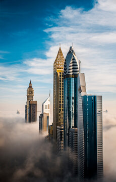 View Of Skyscrapers Against Cloudy Sky