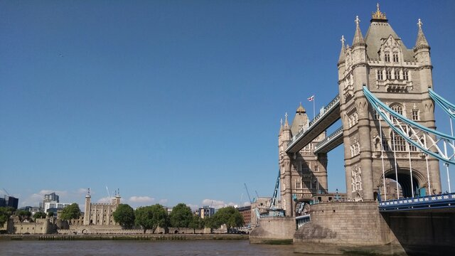 View Of Tower Bridge And The Tower Of London Over River Thames Under A Clean Blue Sky