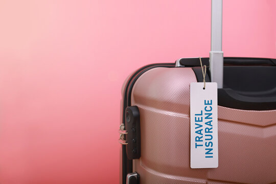 Luggage Against Pink Background