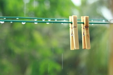 Obraz Close-up Of Clothespins Hanging On Clothesline - fototapety do salonu