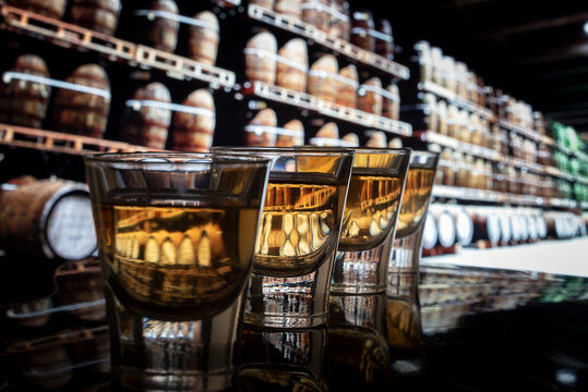 Close-up Of Whiskey In Glasses On Bar Counter