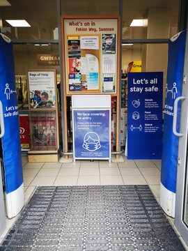Swansea, UK: February 09, 2021: Tesco Express at Swansea Bay Campus with Covid-19 social distancing instructions due to the Coronavirus epidemic of 2020 into 2021.