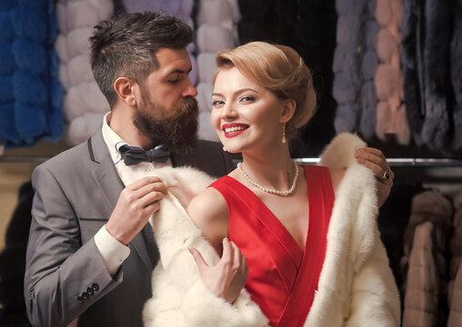 Fashion couple posing in fur coat, fashion.