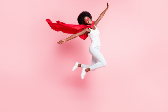 Full length body size view of cheerful skinny girl jumping wearing costume having fun isolated on pink pastel color background