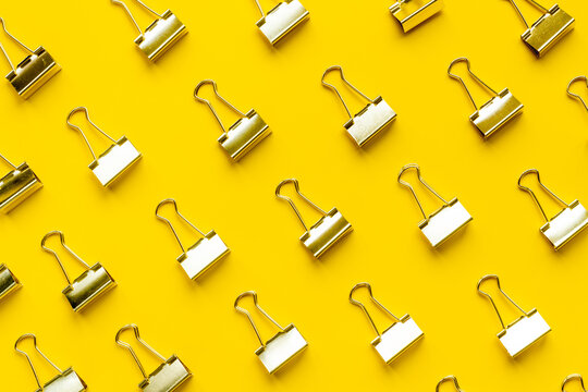 Stationery pattern. Paper binder clips top view