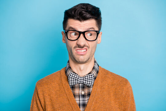 Photo of disgusted funky young guy look empty space dislike news isolated on pastel blue color background