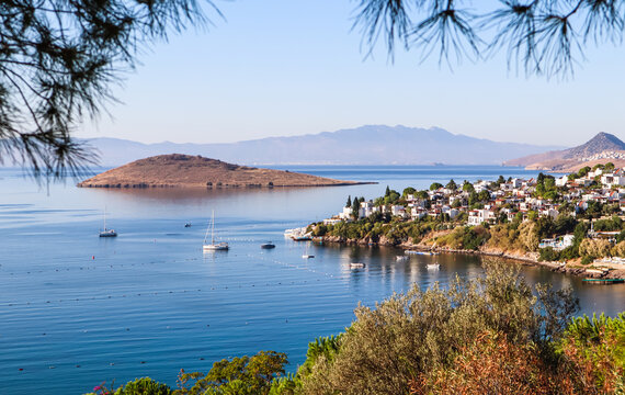 Aegean coastline with wonderful blue water, rich nature, islands, mountains and small white houses. Summer vacation concept.