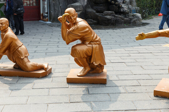 Dengfeng, Henan, China - October 17, 2018: Statues of warrior monks in the Shaolin monastery.