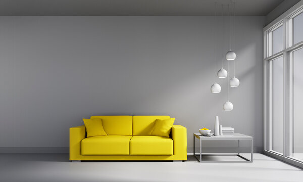 Yellow sofa on empty gray wall background - mock up