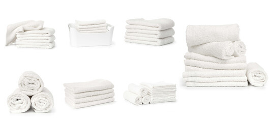 Fototapeta set of white spa towels stacked and in basket isolated on white background