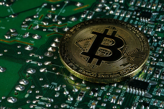 A Bitcoin on a printed circuit board. Bitcoin is a digital cryptocurrency that can be exchanged for other currencies, products or services.