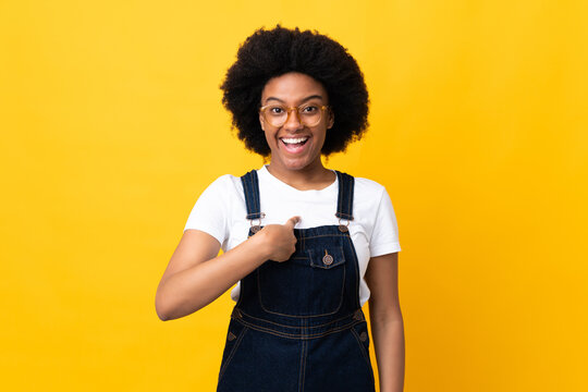 Young African American woman isolated on yellow background with surprise facial expression