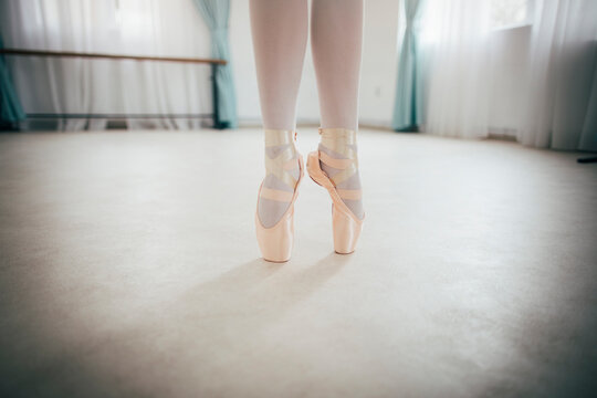 Close up of ballerina legs on pointe shoes