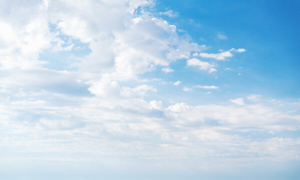 Blue sky with white altocumulus clouds at daytime