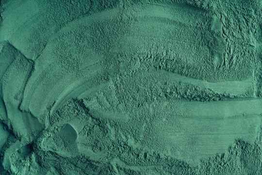 Green background made of spirulina algae powder