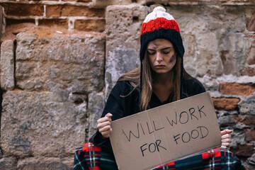 Fototapeta homeless girl sitting on the street. with an inscription that wi obraz