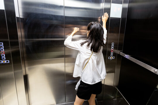 Rear View Of Girl Stuck In Elevator