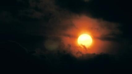 Fotobehang - Dramatic sunset sun shining through dark clouds. Timelapse, 4K UHD.