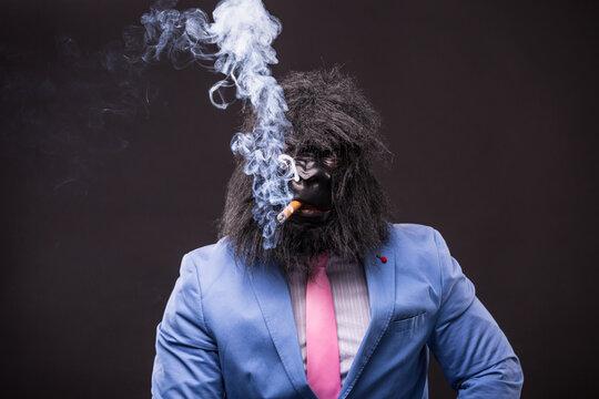businessman wearing gorilla mask