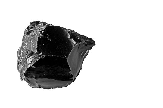 A large piece of Obsidian isolated on a white background. Obsidian is a naturally occurring volcanic glass formed when felsic lava extruded from a volcano cools rapidly with minimal crystal growth.