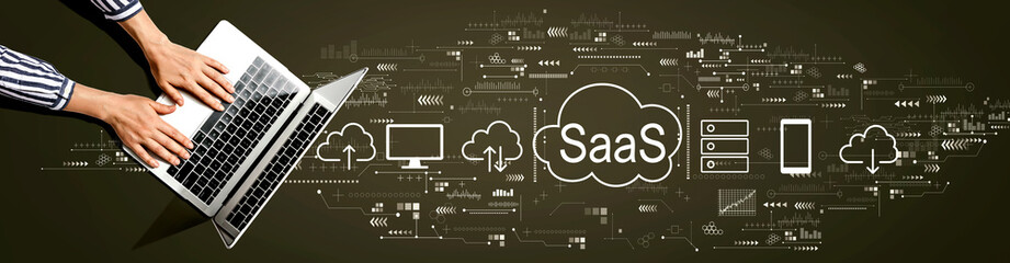 SaaS - software as a service concept with person using a laptop computer