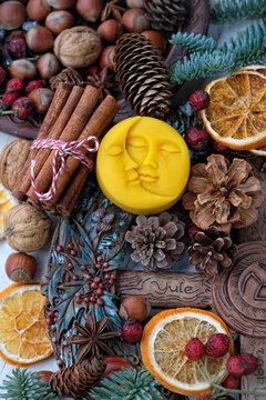 Winter altar for Yule sabbath. pagan holiday. Sun and moon symbol, wheel of the year, cinnamon, nuts, cones, dry orange slices. Witchcraft Ritual for Yuletide, Magical Winter Solstice. flat lay