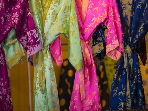 Vietnam, Hoi An. Silk robes hanging in store, old town historic district (UNESCO World Heritage Site).