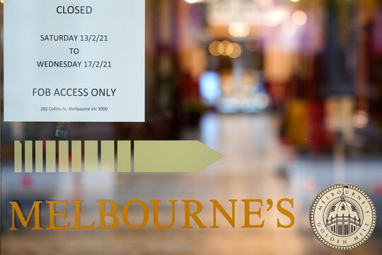 """A """"closed"""" sign is seen at the entrance to a shopping arcade on the first day of a five-day COVID-19 lockdown in Melbourne"""