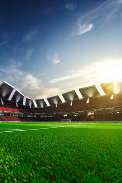 Empty soccer stadium in the evening light
